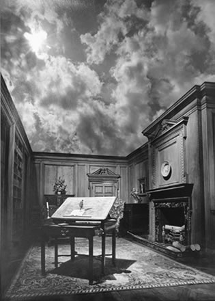 Jerry Uelsmann - Untitled (little man on desk with cloud ceiling)